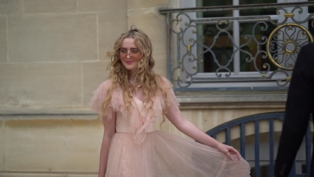 Kathryn Newton wears a pink lace dress and sunglasses outside Dior during Paris Fashion Week Haute Couture Fall Winter 2018/2019 on July 2 2018 in...