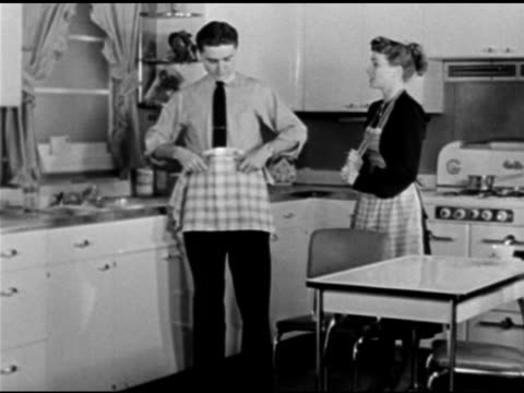 dramatization kathyrn bard paul crabtree on set in kitchen sot discussing who will wash dry 'david' discovering letter from bank on window sill... - window sill stock videos and b-roll footage