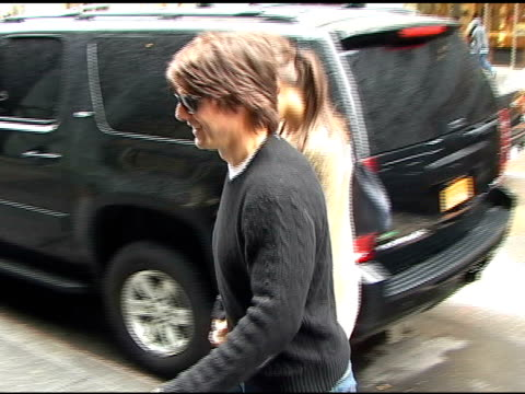 katie holmes and tom cruise are hand and hand as they arrive at their apartment in new york 04/12/11 - tom cruise stock videos & royalty-free footage