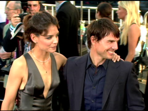 Katie Holmes and Tom Cruise at the Batman Begins Premiere at Grauman's Chinese Theatre in Hollywood California on June 6 2005