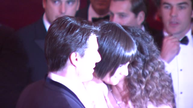 Katie Holmes and Tom Cruise at the Superheroes Fashion and Fantasy Costume Institute Gala at The Metropolitan Museum of Art at the Metropolitan...