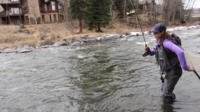 katie is a fishing guide at https://www.facebook.com/andersons.fishcamp anderson's fish camp . here, she shows fellow fishers how to catch a fish in... - https stock videos & royalty-free footage