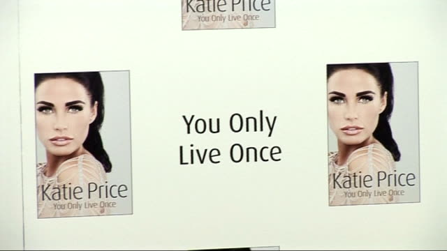 katie price at autobiography book launch england london waterstone's piccadilly photography** poster for katie price's autobiography 'you only live... - biographie stock-videos und b-roll-filmmaterial