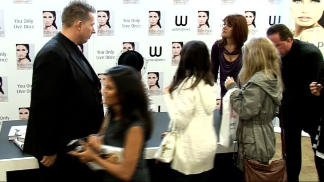 katie price at autobiography book launch; price signing copies of her book for fans / copies of 'you only live once' on display in bookshop - autobiography stock videos & royalty-free footage