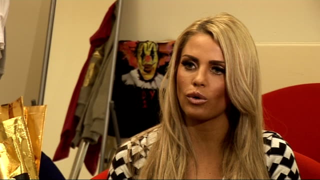 katie price launches new fashion range 'day 22'; katie price interview sot - on meeting the reporter before at the ipod launch / her new new range is... - apple computer stock-videos und b-roll-filmmaterial