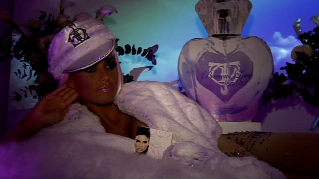 vidéos et rushes de katie price launches new perfume in london; katie price interview sot - on being baking hot surrounded by feathers and fur / on her new perfume... - concurrent