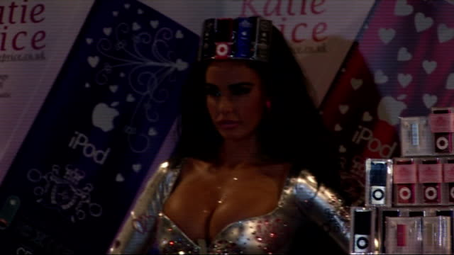 katie price launches new range of ipods england london photography** katie price enters photocall in extravagant and revealing fashion item / general... - mp3 player stock videos & royalty-free footage