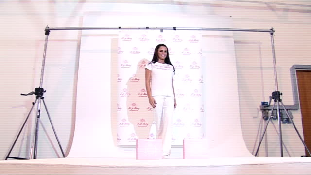 Katie Price launches range of babywear ENGLAND London PHOTOGRAPHY * * Various of Katie Price holding baby wearing items from her new range of...