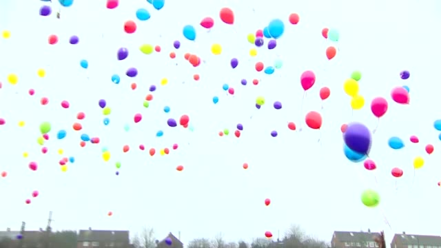 balloons released to mark what would have been her eighth birthday england ext various of people releasing colourful helium balloons into sky im... - releasing stock videos and b-roll footage