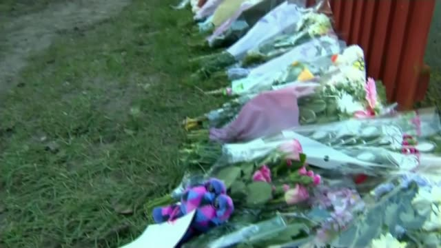 teenage girl given life sentence January 2017 York EXT Floral tributes for Katie Rough lined against fence Message on flowers