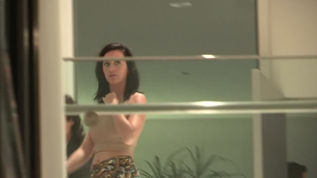 Katy Perry sneaks out of the Prism Listening Party at the Hammer Museum in Westwood 09/12/13