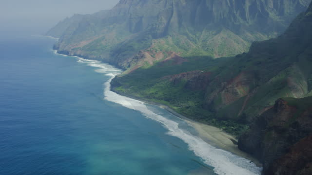 kauai, hawaii napali coast waterfall, aerial shot - na pali coast state park stock videos & royalty-free footage