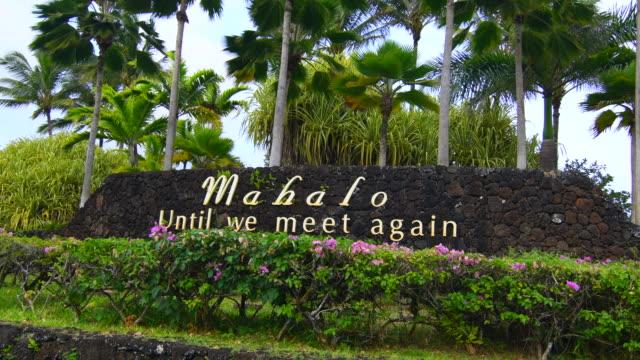 Kauai Hawaii sign Mahalo, thank you, with palm trees for tourists 4K