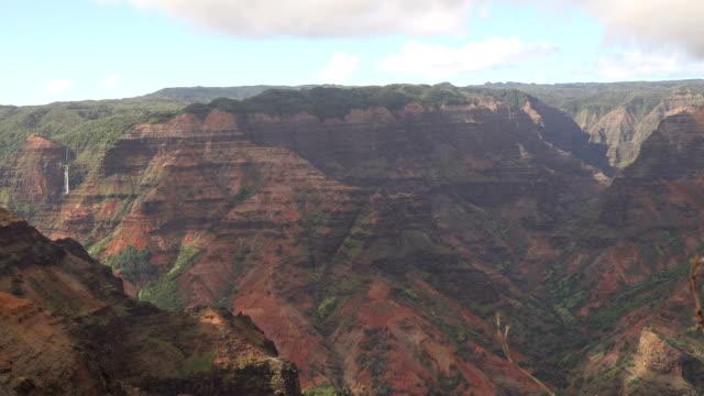 kauai island gorgeous massive ravine between mountains - butte rocky outcrop stock videos & royalty-free footage