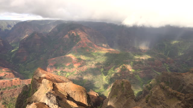 kauai island large mountain peaks and clouds over green landscape - butte rocky outcrop stock videos & royalty-free footage