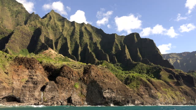 kauai island mountains running down to the coast - butte rocky outcrop stock videos & royalty-free footage