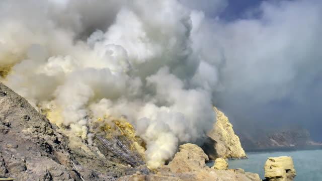 kawah ijen crater lake where the sulfur - erupting stock videos & royalty-free footage