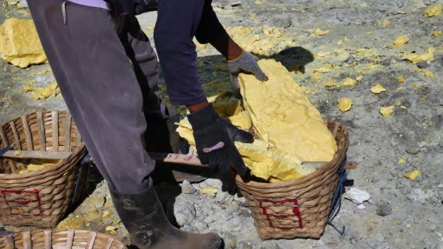 kawah ijen crater lake where the sulfur - sulphur stock videos & royalty-free footage