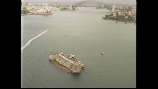 Kay Brown reports on caretakers on Fort Denison retiring Aerial Fort Denison Sydney Harbour Bridge and Opera House in background / June and Cliff...