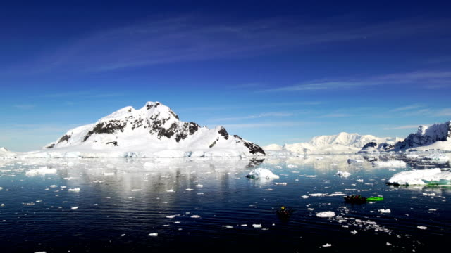 kayak amongst the icebergs - ice floe stock videos & royalty-free footage