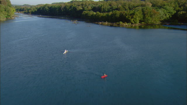 low aerial kayak and rowing scull on potomac river near cabin john, maryland, usa - 復元する点の映像素材/bロール