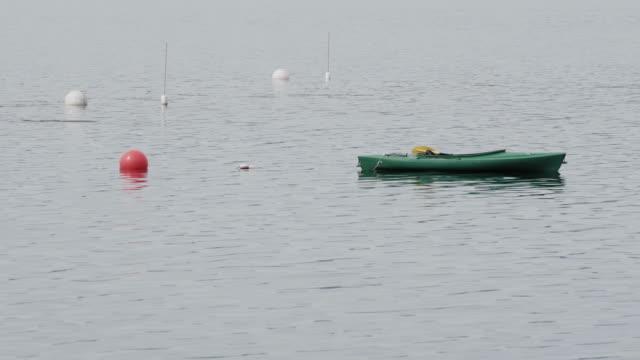 Kayak floating in Maine bay