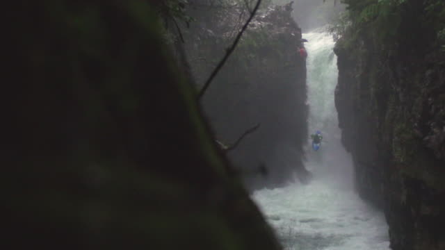 kayaker comes down waterfall in slow motion - kayak stock videos & royalty-free footage