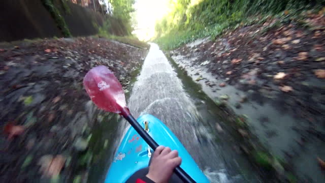 pov of kayaker descending drainage canal into mtn laker - drainage stock videos and b-roll footage