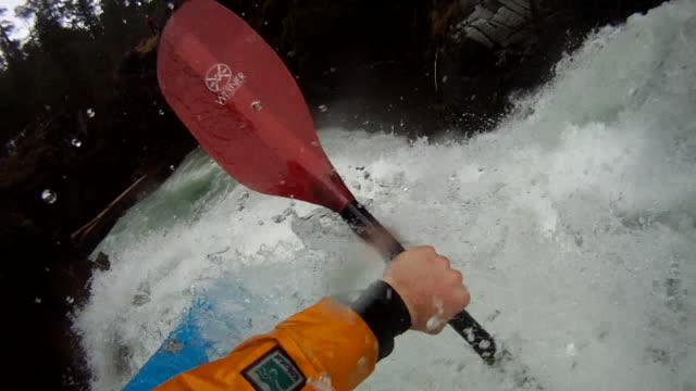 POV of kayaker descending turbulent mtn river