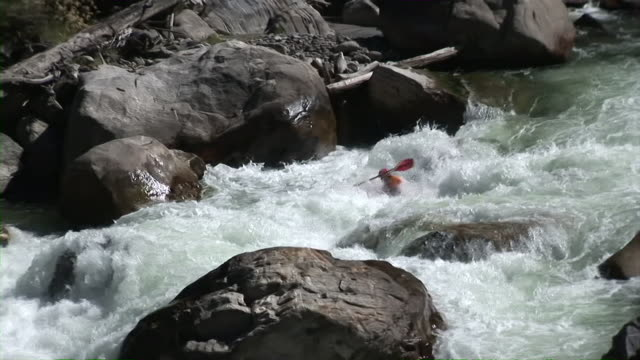 kayaker descends extreme whitewater rapid - canoeing stock videos and b-roll footage