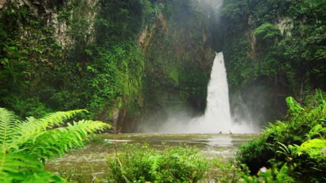 kayaker drops down massive jungle waterfall - physical geography stock videos & royalty-free footage