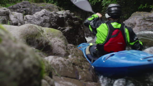 kayaker flies through raging rapids - rafting stock videos and b-roll footage