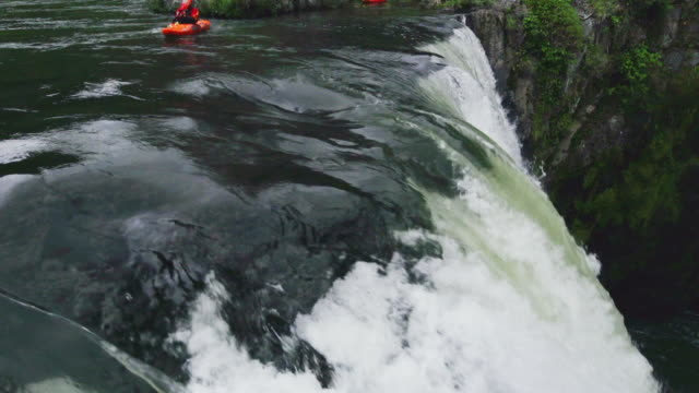Kayaker goes over massive waterfall