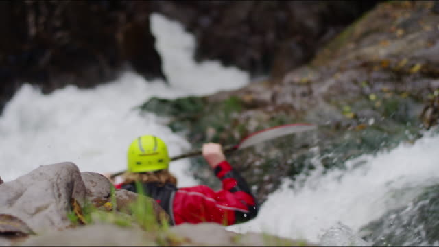Kayaker navigates narrow rapids