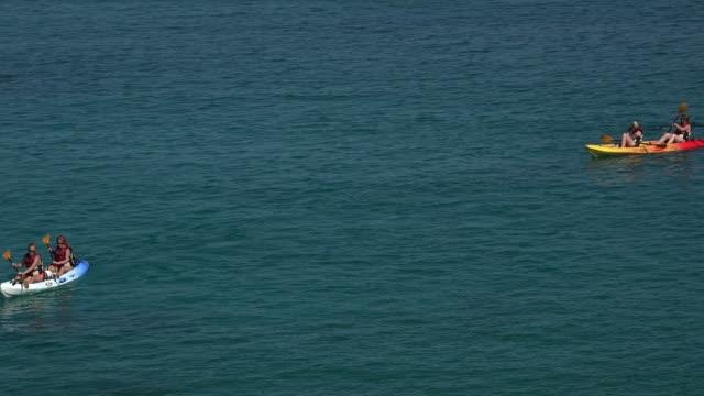 vídeos de stock e filmes b-roll de kayaker on the sea, cala san vicente, majorca, balearic islands, spain, mediterranean, europe - fotografia de três quartos