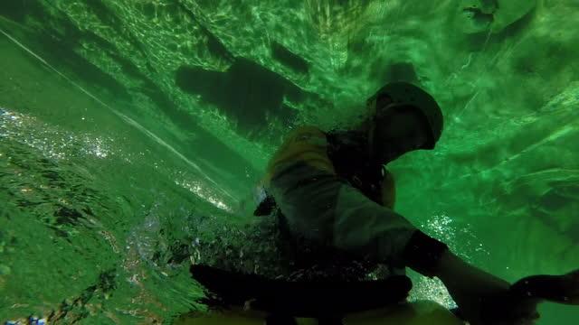 Kayaker rolls underwater
