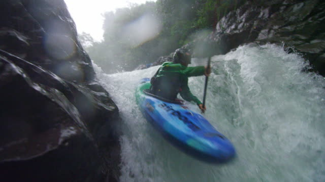 kayaker runs waterfall in slow motion - rapid stock videos & royalty-free footage