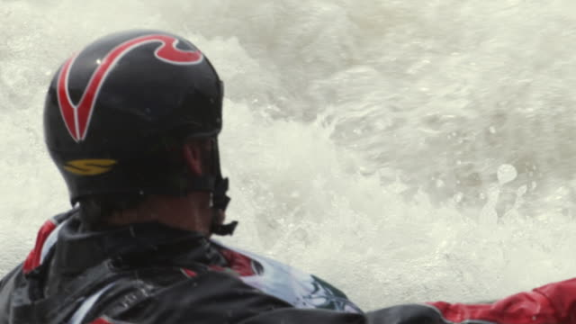 SLO MO CU Kayaker swimming in river rapids, Glenwood Springs, Colorado, USA