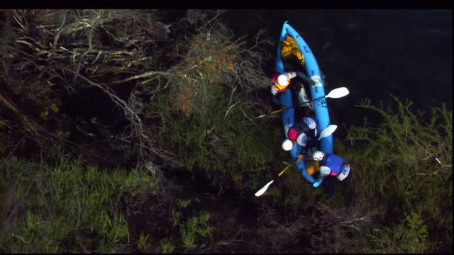 kayakers approach a riverbank in patagonia. - rafting stock videos & royalty-free footage