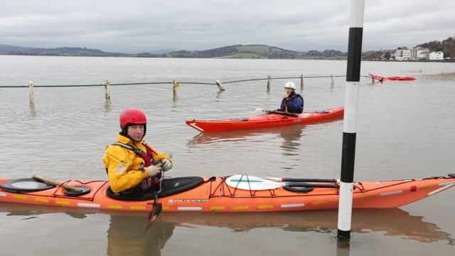 kayakers in flood waters on the road at storth on the kent estuary in cumbria uk during the january 2014 storm surge and high tides - kayak stock videos & royalty-free footage