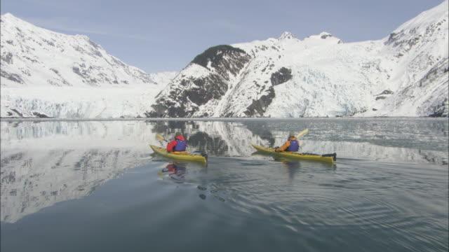 kayakers paddle across prince william sound. - prince william stock videos & royalty-free footage