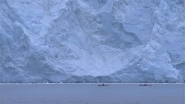 kayakers pass by glaciers calving on the kenai peninsula. - kenai peninsula stock videos & royalty-free footage