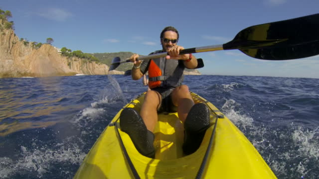 kayaking along the costa brava in catalonia, spain - using a paddle stock videos & royalty-free footage