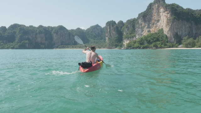 4k uhd: kayaking back to shore - thailand stock videos & royalty-free footage