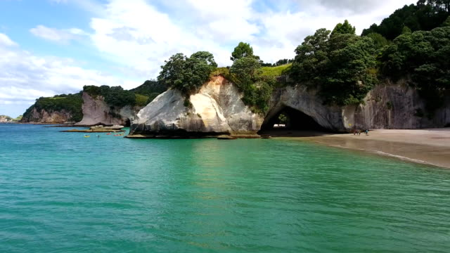 kayaking, cavern, cathedral cove, cliffs, beach, rocks, sea, coromandel, - cathedral rocks stock videos & royalty-free footage