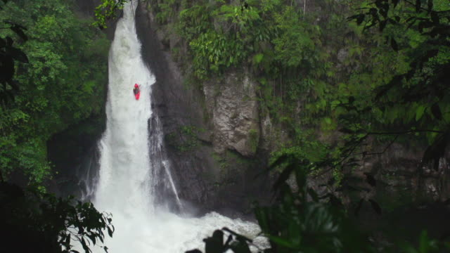 kayaking down jungle waterfall in slow motion - kayak stock videos & royalty-free footage