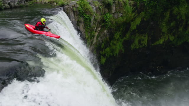Kayaking down jungle waterfall