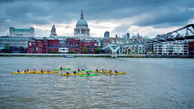 kayaking group of people at leisure at london. moody sky - swimwear stock videos & royalty-free footage