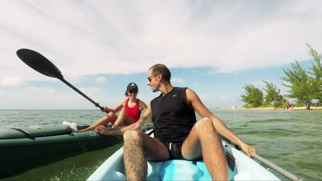 Kayaking in a tropical beach in Caribbean - Grand Cayman Island