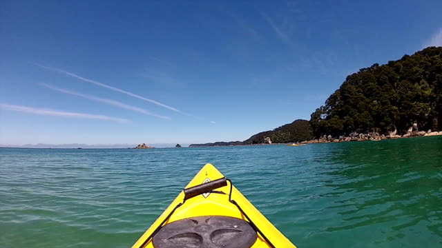 kayaking in abel tasman national park, new zealand - canoe stock videos & royalty-free footage